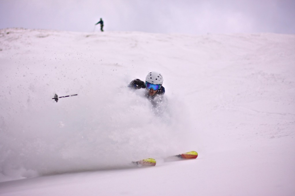 Skier Shreding Powder