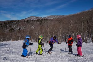 Ski instructor with group