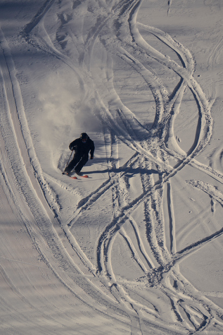 skier showing first tracks